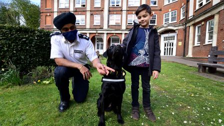 Chief Superintendent Raj Kohli (left) and eight-year-old hospital visitor Stefan Jenner