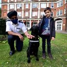 Chief Superintendent RajKohli (left)and eight-year-oldhospital visitor Stefan Jenner