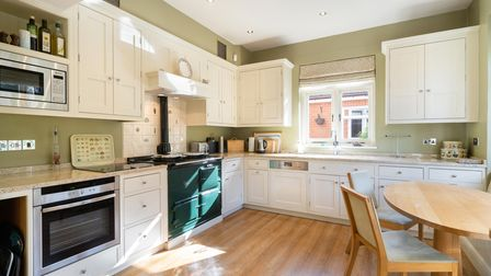 The kitchen/breakfast roomleads to alaundry room and conservatory.