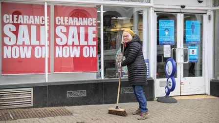 A volunteer cleans up the pavement on King Street, Saffron Walden, Big Clean Up Day, April 2021