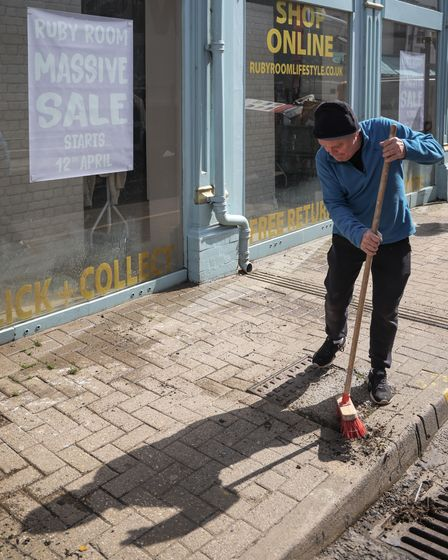 Cleaning up outside the Ruby Rooms on the High Street Saffron Walden, April 2021