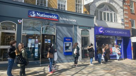 Queues outside the Cancer Research UK shop in Angel as non-essential shops reopened on April 12