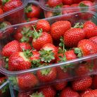 Strawberries for sale on a stall in Berwick Street market, London.