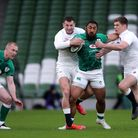Ireland's Bundee Aki is tackled by England's Jonny May (left) and Owen Farrell (right) during the Gu