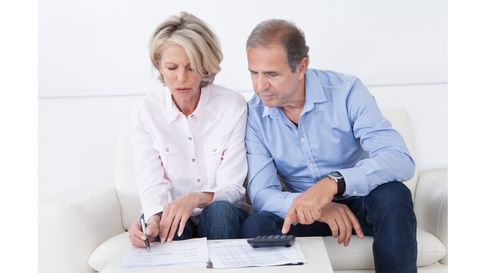 Mature couple doing family finances at home