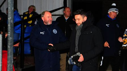 Father and son... Lee Johnson, then manager of Bristol City, shakes his dad Gary Johnson's hand