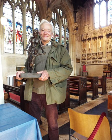 Sculptor Rodney Munday at Cirencester Parish Church, with his Virgin and Child maquette