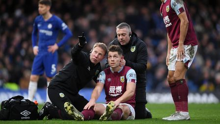 James Tarkowski of Burnley is assessed for concussion during a match between Chelsea and Burnley in January 2020