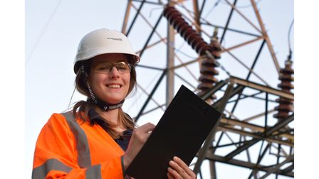 Female power firm worker with clipboard