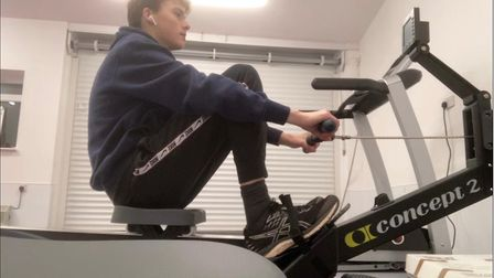 A young man on rowing machine