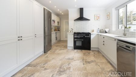 The impressive kitchen / dining room features solid quartz worktops and a range-style cooker.