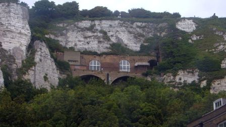 Visitor Entrance to Secret Wartime Tunnels aka Hellfire Corner can be seen upon the cliffside in Dover