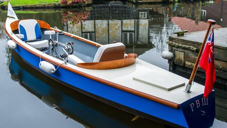 A beautiful, sleek Norfolk-built pedal boat in the water