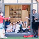 Head teacher Jenny Lewis cuts the ribbon at the launch of the new library at Thornhill School in Barnsbury