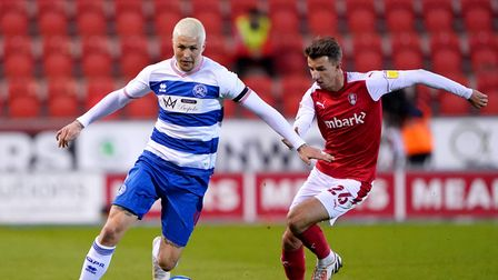 Queens Park Rangers' Lyndon Dykes (left) and Rotherham United's Daniel Barlaser battle for the ball