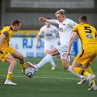 Danny Wright of Torquay United competes for possession with Robert Milsom of Sutton United amid the
