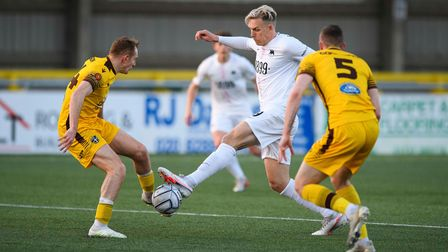 Danny Wright of Torquay United competes for possession during the match between Sutton United and Torquay United on Tuesday.