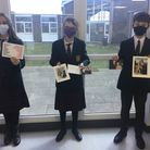 Year 7 students at Ormiston Denes Academy in Lowestoft with their cards.