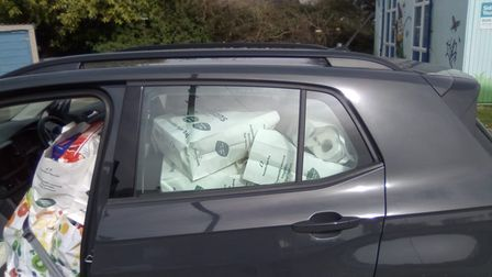 A car load of food bags ready to be delivered