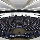Members of the European Parliament take part in a voting session during a plenary session at the Eur