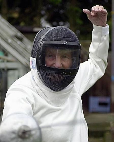 Connie Adam, pictured aged 74, in her fencing gear.