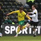 Max Aarons of Norwich and Max Bird of Derby County in action during the Sky Bet Championship match a