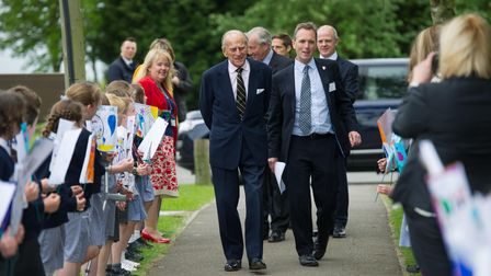 Duke of Edinburgh is welcomed by local school pupils to Grafham Water in May 2016.