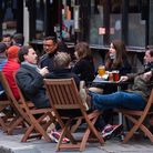 File photo dated 17/10/20 of drinkers outside a pub in Soho, London. A pint at the pub is finally a
