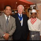 Bekash owner Solly Ahmed (l) with former Mayor of Havering Cllr Roger Ramsey and chefMukith Miah (r)
