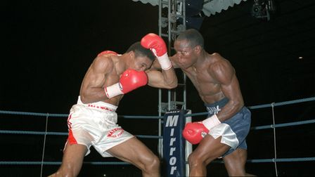 Chris Eubank lands a punch to Michael Watson's head during their WBO title fight at Tottenham's Whit