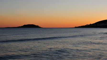 A perfect sunset leaves Looe Island in shadow.