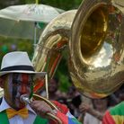 Man wearing a costume playing the tuba, parade at the International Carnival of Victoria, Seychelles