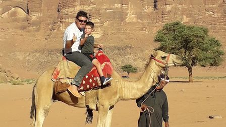 Justin and Oscar on a camel ride in Jordan