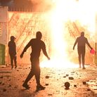 Fire fed by petrol burns as youths clash with police atBelfast's Springfield road/Lanark Way interface in early April
