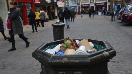 Several bins around the city centre are overflowing with rubbish as people return to the city's stre