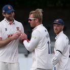 Simon Harmer of Essex celebrates with his team mates after taking the wicket of Charlie Morris durin