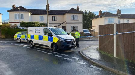 A forensics van and police car put a cordon up on Primrose Crescent.