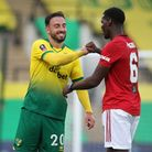 Josip Drmic of Norwich and Paul Pogba of Manchester United at the end of the FA Cup quarter final at