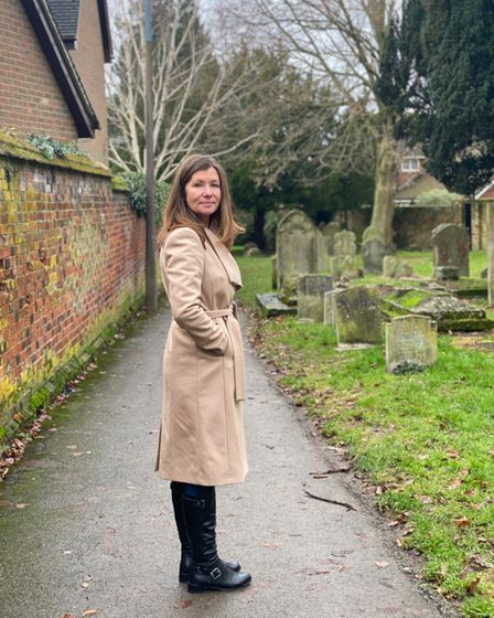 Author Rachel Lynch in the churchyard of St Mary's in Baldock