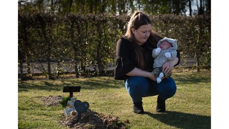 Jade and Theo-Lee, next to the grave of her first baby, Macaulay