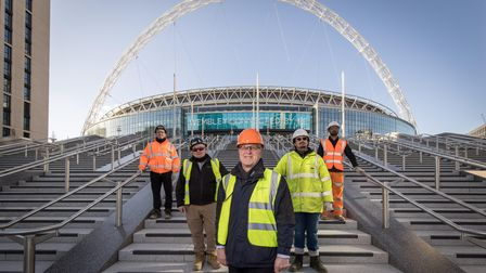 Pictured James Saunders, CEO of Quintain with workers on the Olympic Steps.Wembley Park, one of Eu