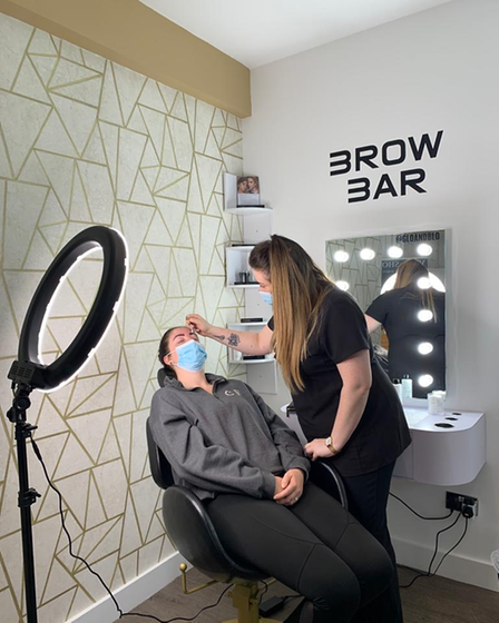 Client Chloe Needham getting HD Brow Sculpt by Glo & Blo's beauty specialist,Katherine Terry