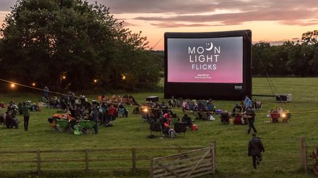 An outdoor cinema as the sun goes down