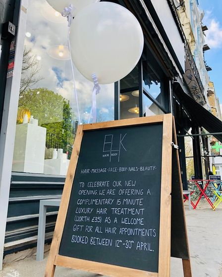 The sign and balloons outside of ELK Hair+Beauty