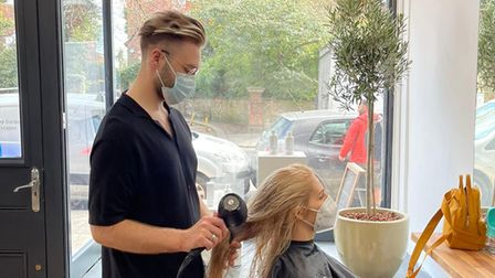 Elivinas Piscikas with one of the first customers at ELK Hair + Beauty in Belsize Park