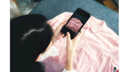 Take photos of clothing you want to sell as you go along so you can sell it online