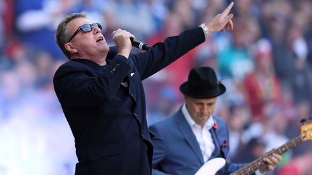 Suggs of Madness on stage at Wembley Stadium before an NFL game in 2015