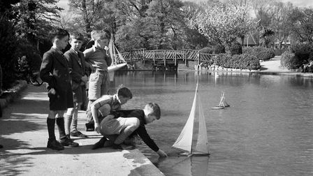 Boys with boats on the lake at Kings Gardens, Torquay