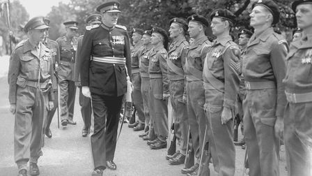 Sir Edmund Bacon inspecting the guard of honour at the Second World War Memorial Bungalows on Mousehold Lane, Norwich