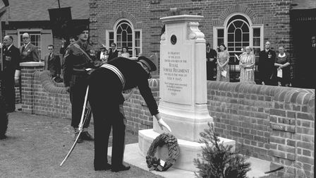 Sir Edmund Baconlays a wreath at the Second World War Memorial Bungalows on Mousehold Lane, Norwich 1951.